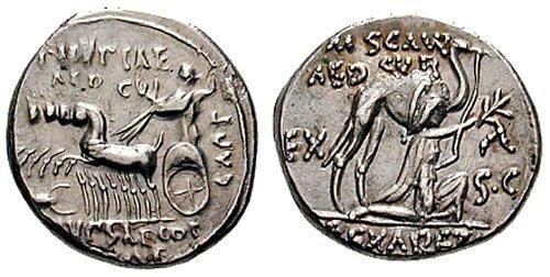 n°18. Denier républicain, M. Aemilius Scaurus et Pub. Plautius Hypsaeus. 58 av. J.C. A/ Chameau tourné à droite, un  personnage agenouillé devant lui. R/ Jupiter dans un quadrige tourné à gauche; un scropion devant.