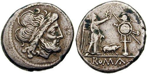 n°22. Anonyme, 206-195 av. J.C. Victoriat. A/ Tête laurée de Jupiter tourné à droite. R/ ROMA en exergue, Victoire debout tournée à droite couronnant un trophée; un porc entre les deux.