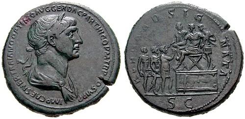 Sesterce de Trajan, frappé en 116. A/ IMP CAES NER TRAIANO OPTIMO AVG GER DAC PARTHICO PM TR P COS VI PP. Buste lauré drapé tourné à droite. R/ REGNA ADSIGNATA. Trajan assis sur une estrade placée à droite. Derrière lui, le préfet du prétoire. Devant, un soldat debout tenant une haste. Au pied de l'estrade, 3 rois debout. [Cohen n°325]. Photo © ?