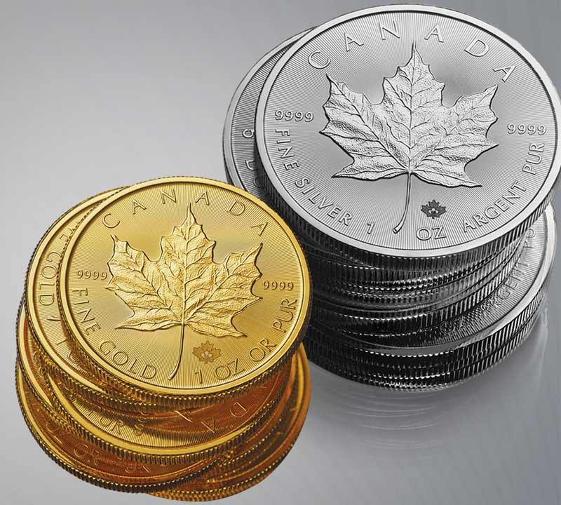 Photo de piles de pièces d'or et d'argent Feuille d'érable du Canada