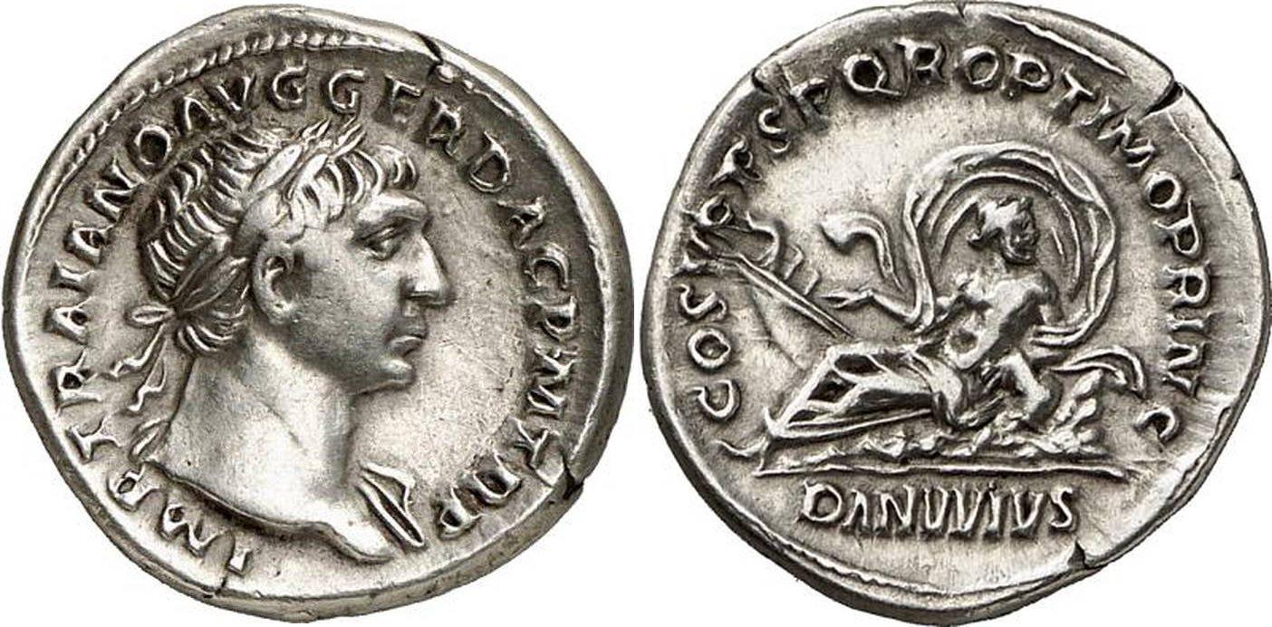 MONNAIE 1. - Denier de l'Empereur Trajan (98-117 après JC). Poids de la monnaie : 2,93 grammes. Monnaie frappée en 103-111 après JC. Avers de la monnaie : IMP TRAIANO AVG GER DAC P M TR P, Buste drapé tournée à droite. Revers de la monnaie : COS V P P S P Q R OPTIMO PRINC / DANVVIVS, Le Danube couché.