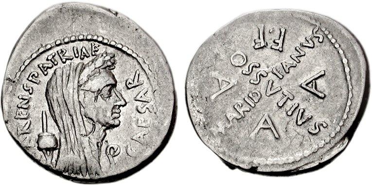 Denier frappé en 44 avant JC, représentant Jules César. Un signe rond a été apposé à sur le portrait de César.