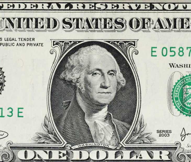 Gros plan d'un billet de 1 dollar américain, un modèle à suivre selon Louis Giscard d'Estaing